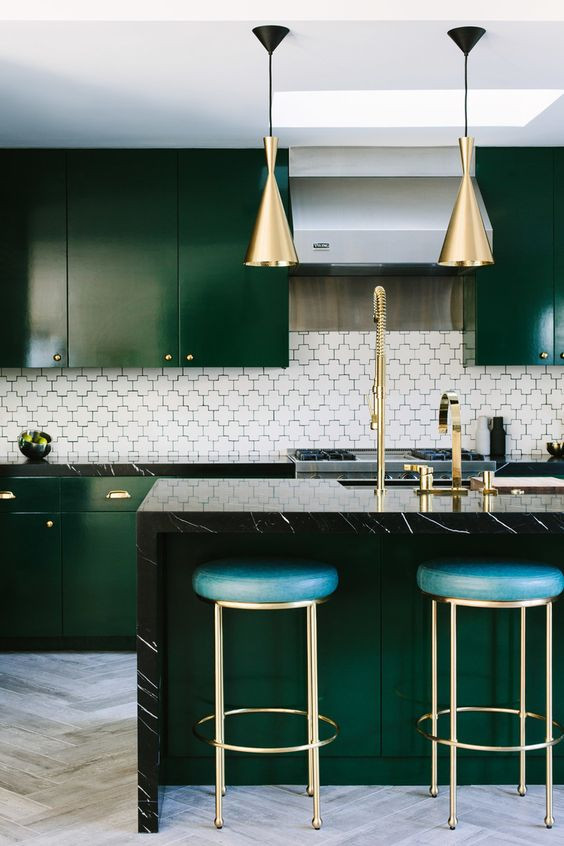luxurious kitchen green herringbone tiles brass lights brass stools