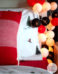 Junior Bedroom Christmas Styling cotton ball lights and skier bed linen chalet decor