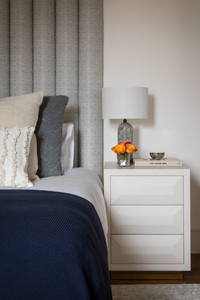 Bed with vertical scalloping