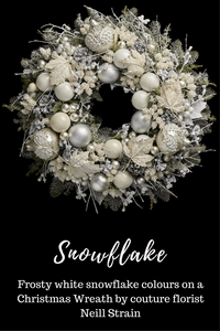 frosty white snowflake coloured Christmas wreath by luxury florist Neill Strain