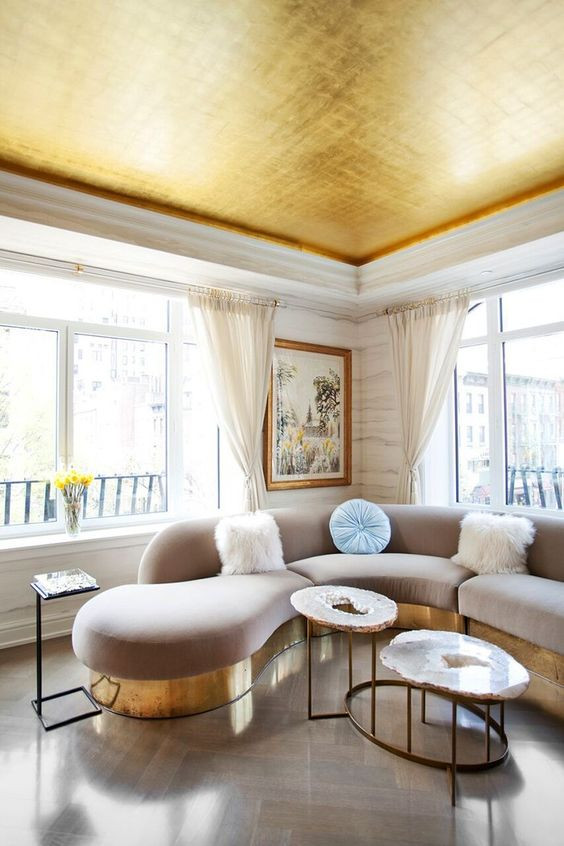 A gold painted living room ceiling
