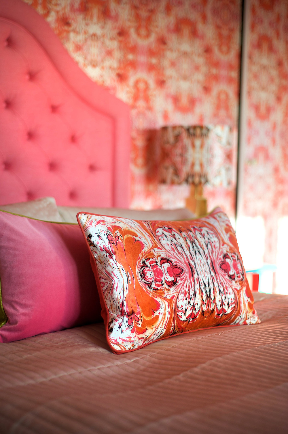 orange feathered wallpaper and cushion in bedroom, Susi Bellamy wallpaper and fabrics