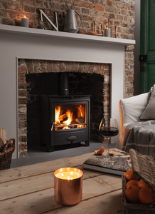 A traditional looking Arada stove in a cottage setting