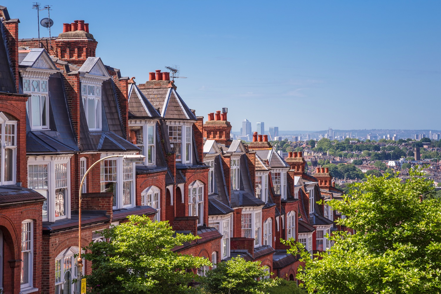 Brick houses of Muswell Hill and panorama of London with Canary Wharf, London, UK_edited