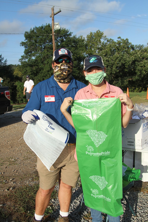Past SRTU President Sam Crews and his wife Mary Margaret geared up to clean up!