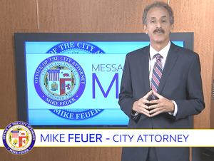 City Attorney Mike Feuer in front of video monitor