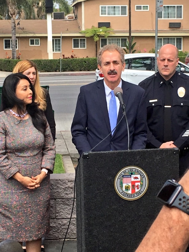 City Attorney Mike Feuer at podium with Councilmember Nury Martinez