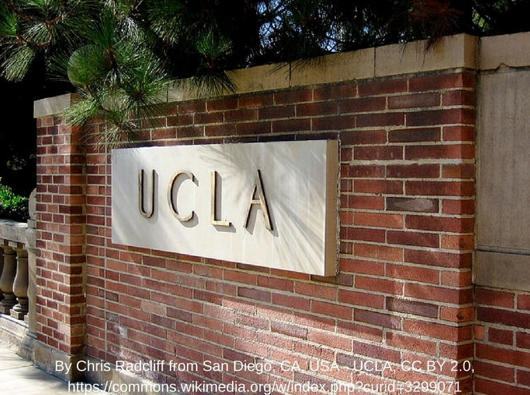 brick UCLA sign from campus