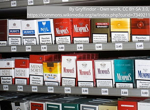 Rows of dozens of packs of various brands of cigarettes.