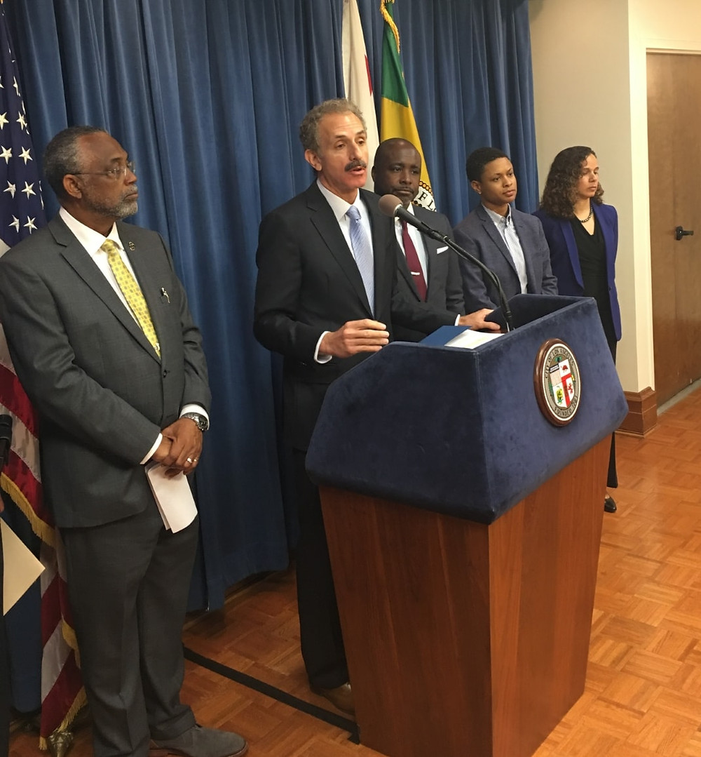 City Attorney Mike Feuer at podium leading press conference