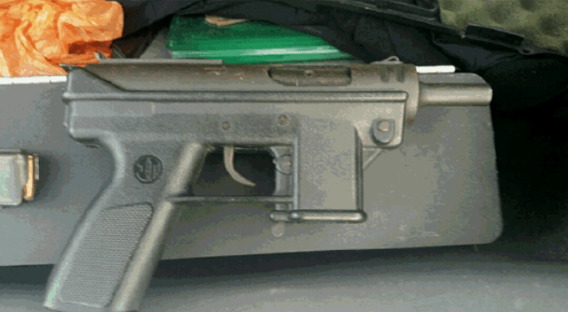 An unlocked assault weapon recovered by LAPD - a dark gray metal gun.
