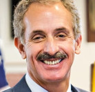 Official heashot of Los Angeles City Attorney Mike Feuer, who is smiling with the top of his suit visible.