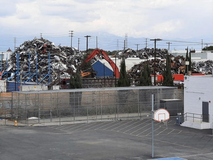 TO PROTECT STUDENTS, FEUER TARGETS SOUTH LA SCRAP METAL CO. NEXT TO JORDAN HIGH FOR ALLEGED NUISANCE