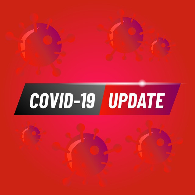 """Bright red stock graphic that says """"COVID-19 Update"""" on a background of COVID spiked cells."""