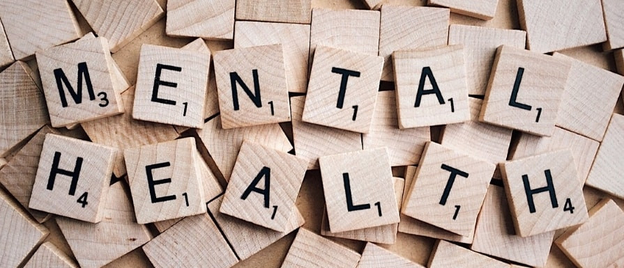 """Scrabble tiles spelling """"Mental Health."""""""