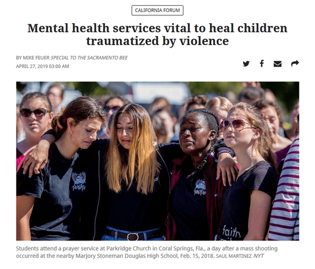 Screenshot of the Sacramento Bee newspaper which a group of teenagers hugging after a school shooting, under the headline, Mental health services vital to heal children traumatized by violence.