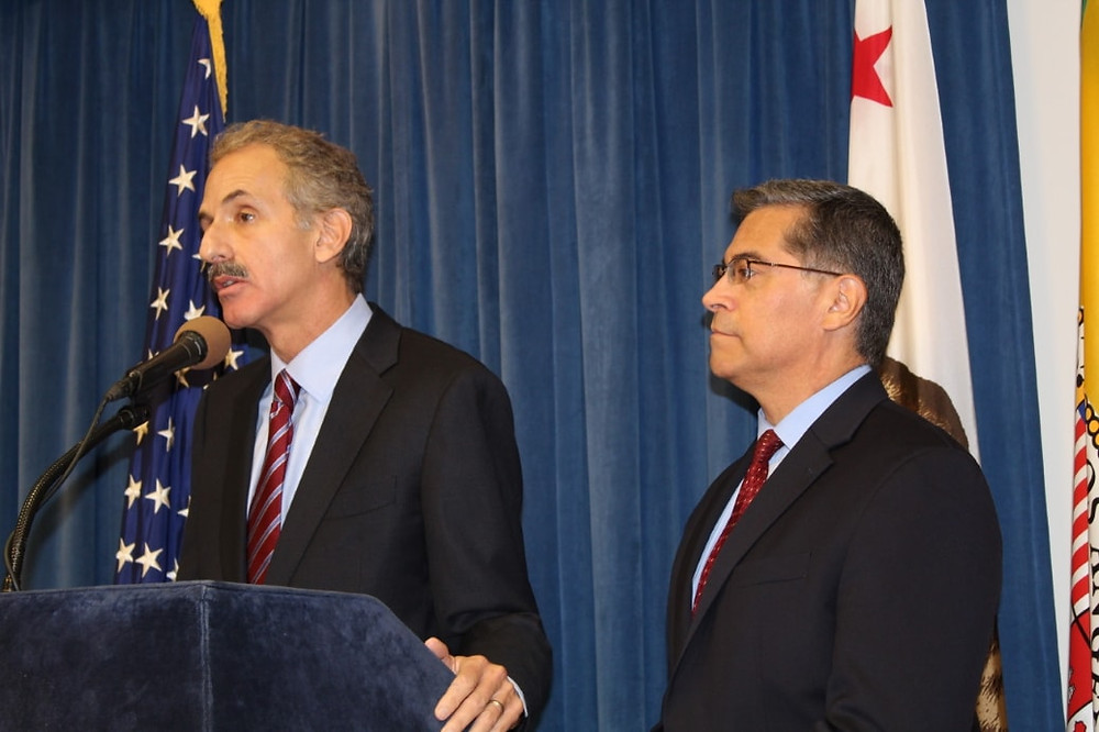 City Attorney Mike Feuer at the podium with California Attorney General Xavier Becerra