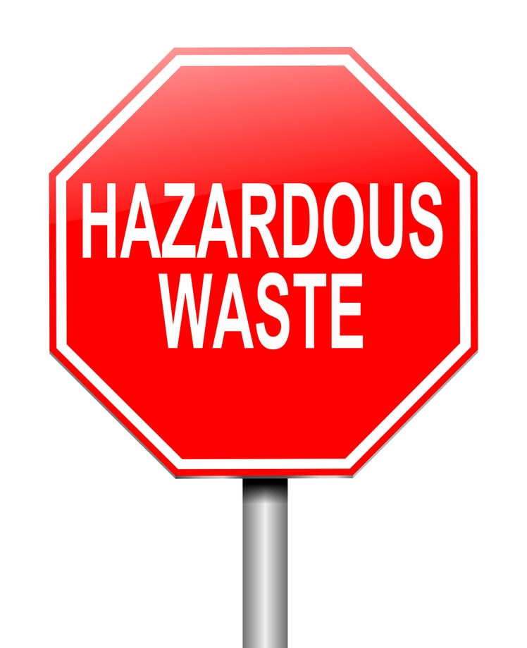 """Stock graphic image of a bright red stop sign with the words """"Hazardous Waste"""" on it in white."""