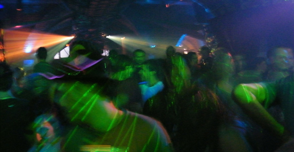 Stock photo of people dancing in a dark nightclub.