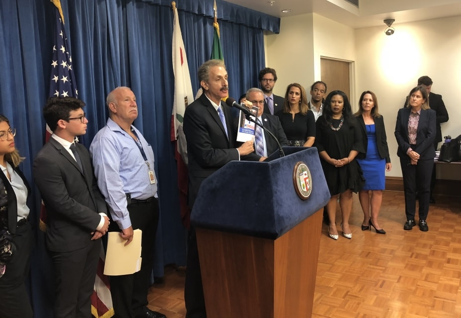 City Attorney Mike Feuer at podium flanked by members of Blue Ribbon Panel on School Safety