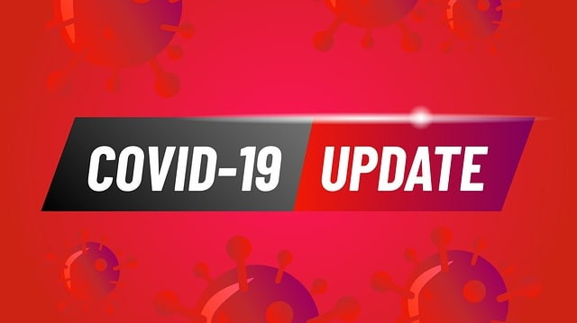 """Bright red graphic with red COVID-19 spiked cells on it and a banner in front of it which says, """"COVID-19 UPDATE."""""""