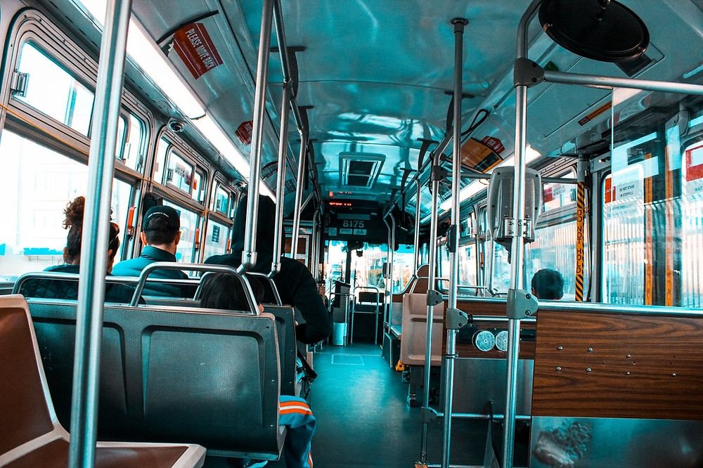 Stock photo of a clean and bright bus interiror, taken from the back.