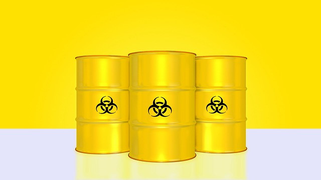 Graphic illustration of three garbage cans implying the alleged hazardous waste.