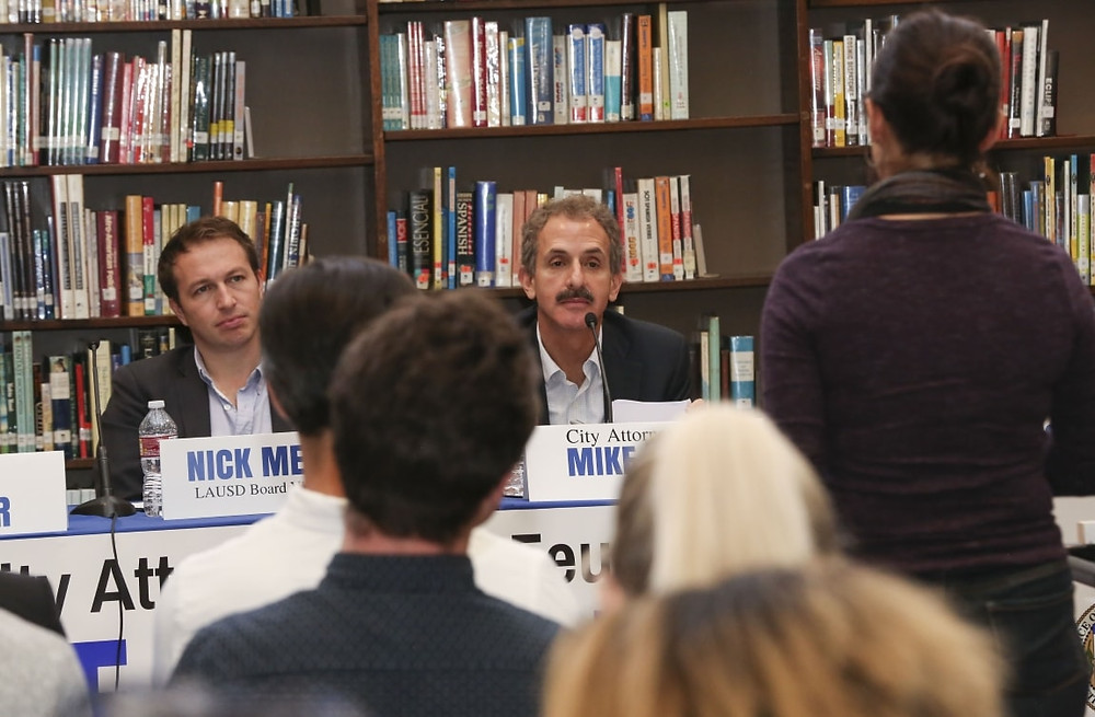 City Attorney Mike Feuer and LAUSD Board Member Nick Melvoin behind table