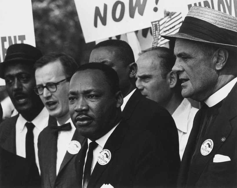 Black and white photo of Dr. Martin Luther King Jr. speaking at the March on Washington in 1963.