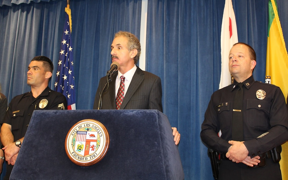 City Attorney Mike Feuer flanked by flanked by LAPD Hollywood's Senior Lead Officer Ben Thompson (l) and Captain Steve Lurie.