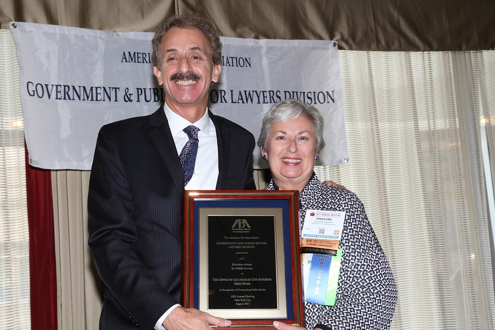 City Attorney Mike Feuer smiles as he accepts the Hodson Award from Pauline Weaver, Government and Public Sector Lawyers Division Chair, for the American Bar Association.