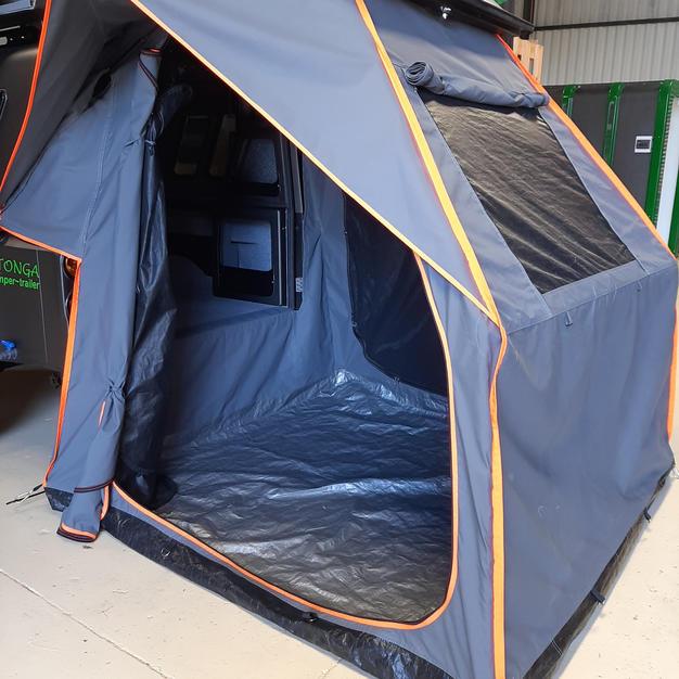 Drop down tent