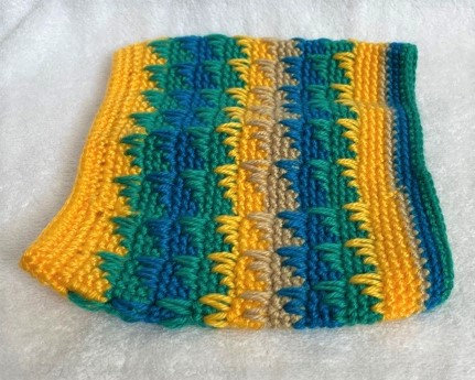 Knitted Snood with yellows,blues,greens, and tan.
