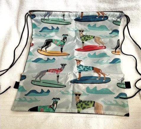 Greyhounds surfing drawstring bag