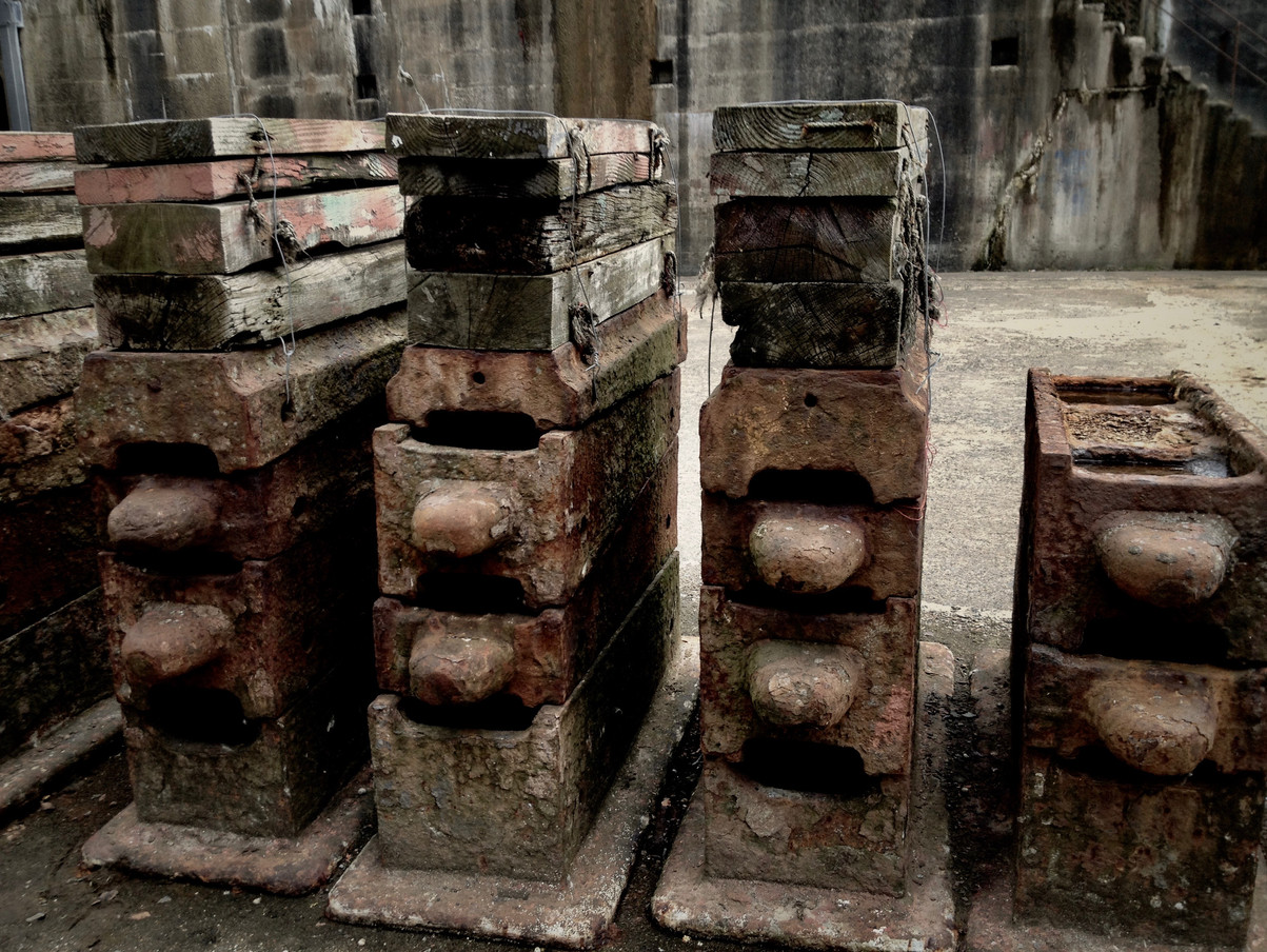 One cuts stacked together in Titanic dry-dock these would be once used to hold the haul upright.