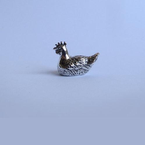Silver hen figurine