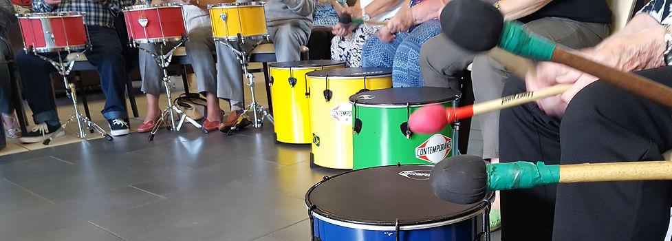 Seated Samba Drumming photo by Mika