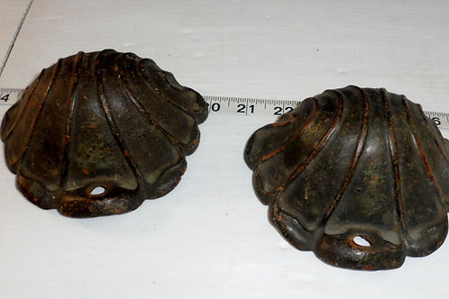 Pair Of Cast Iron Shell Covers