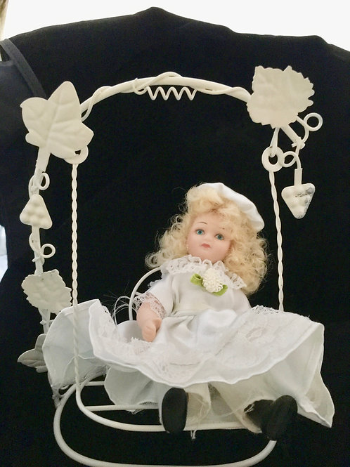 Vintage Porcelain Doll in Wire Swing
