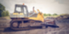 yellow-and-brown-metal-pay-loader-on-he-