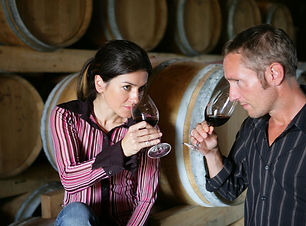Man and woman tasting a glass of red win