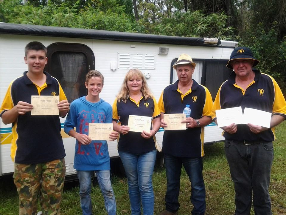 Uralla Bowmen Archers showing off their prizes at a recent field archery competition.