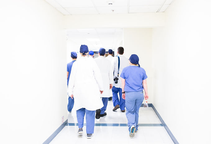 nurses walking down a hospital hallway..