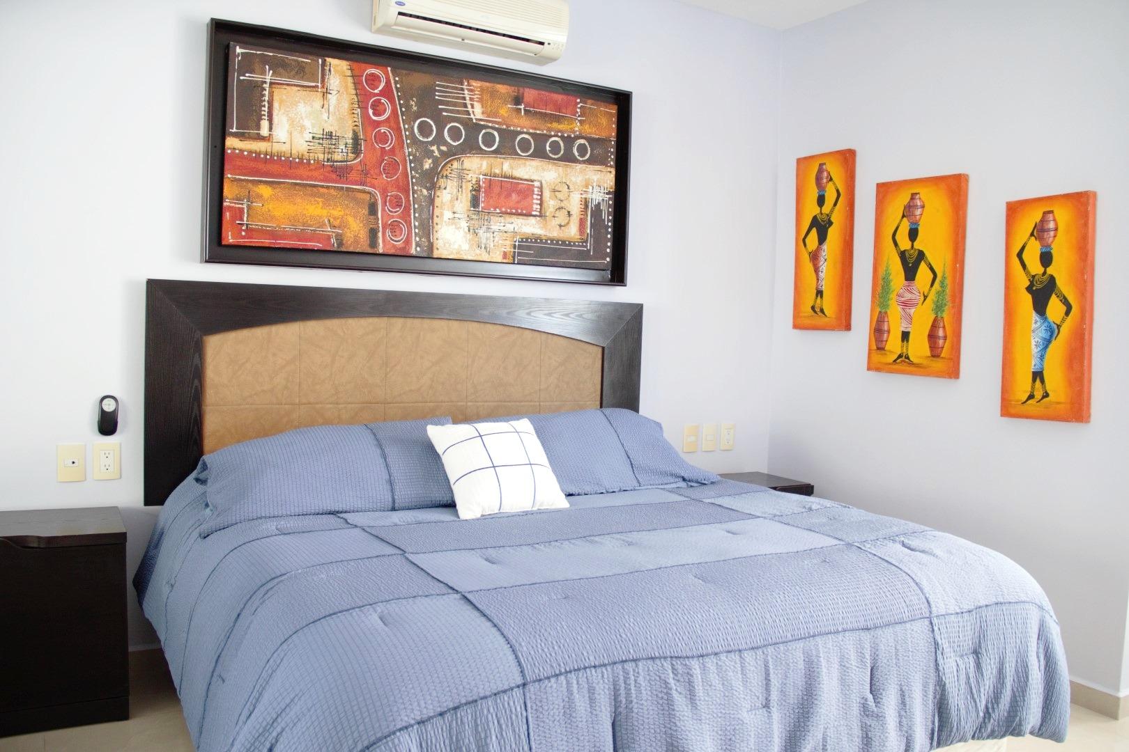 Kingsize bed in third bedroom.