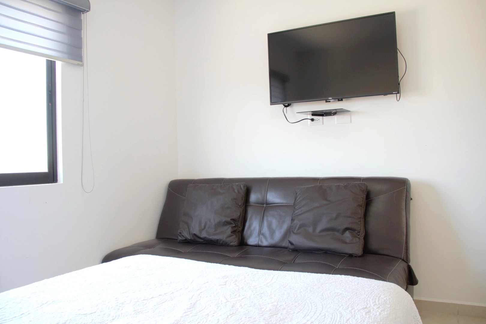 TV and sofa-bed in third bedroom.