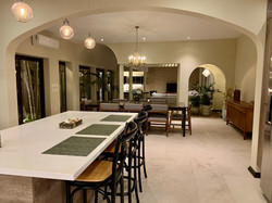 Evening views of kitchen and dining room.