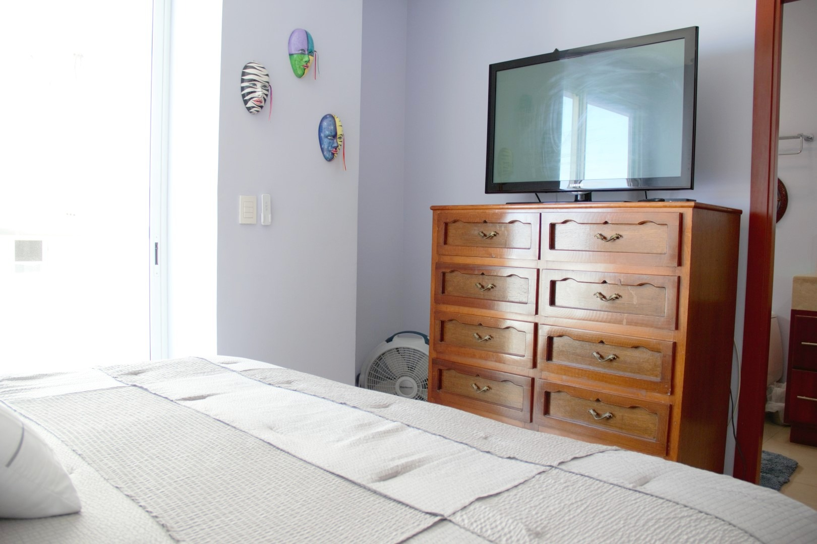 TV and dresser in second bedroom.