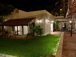 Private yard with lighting.