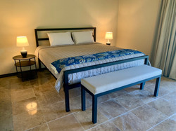 Second bedroom with king-size bed.