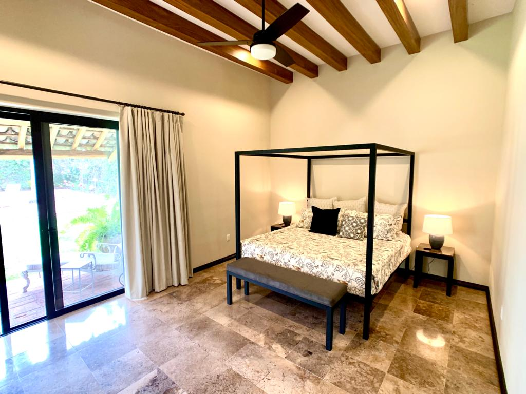 Master bedroom with patio access.